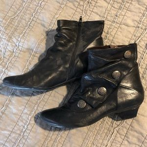 Black leather ankle boots with silver accents